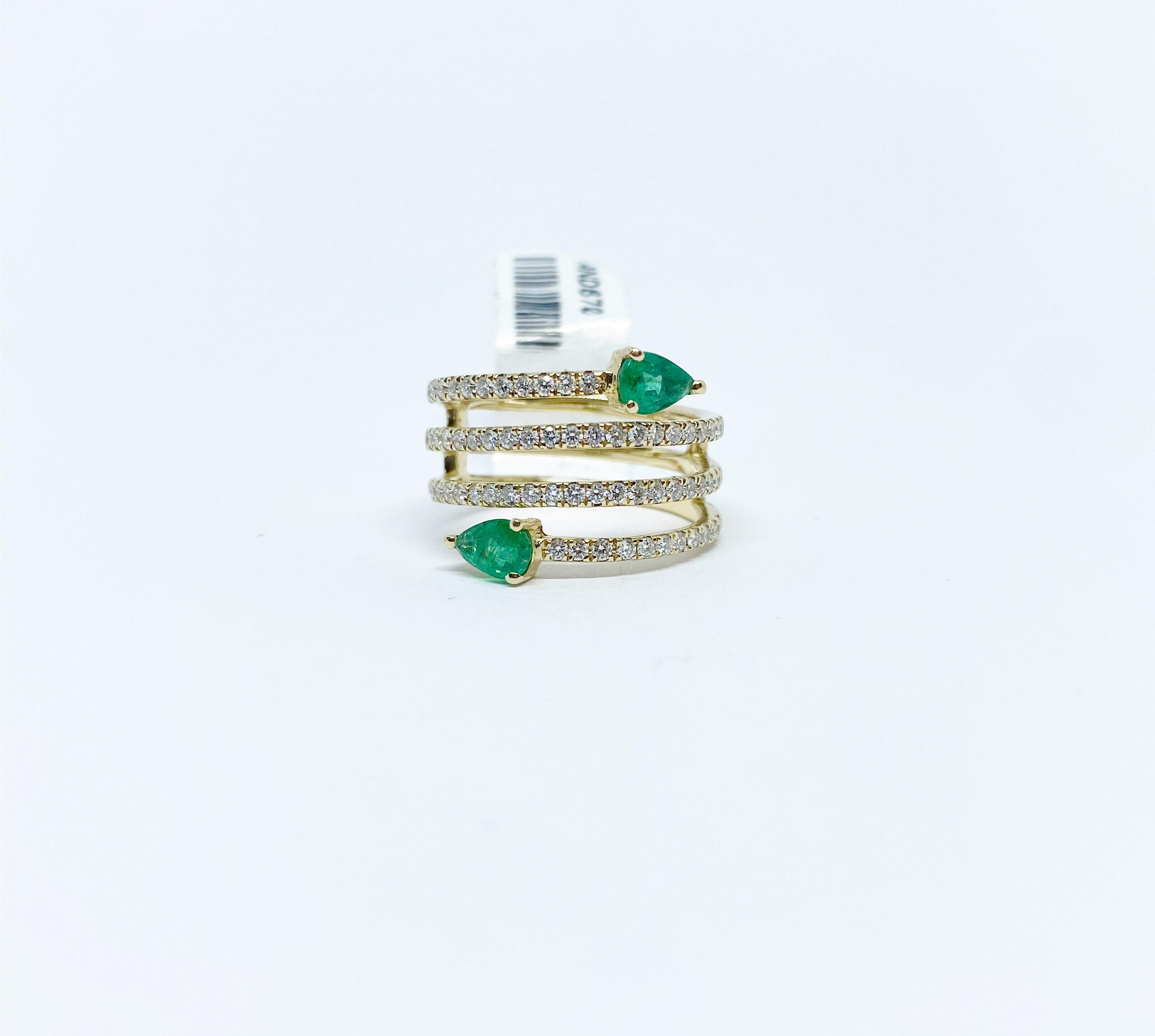Anillo Espiral Diamantes con Esmeralda